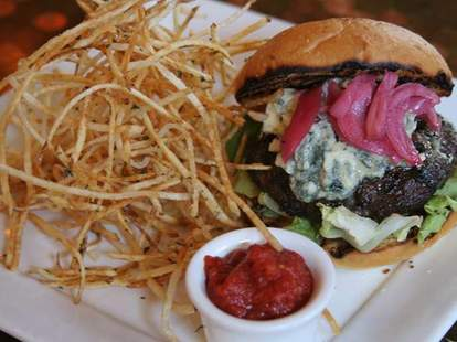 The blue cheese burger with shoestring fries at East Side Showroom