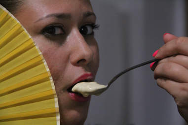 A girl savors a teaspoon of Morimoto Miso Honey Ice Cream