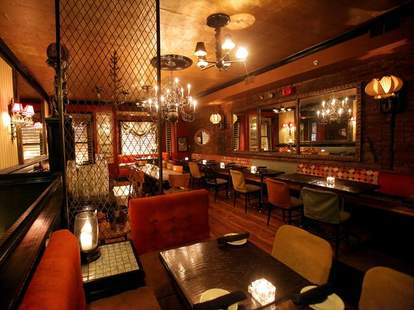 The inside of 1905 is covered in velvet orange chairs and intricate metalwork walls.