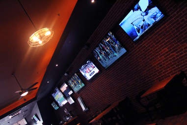 The TVs lining the dining room at Sto's Bar