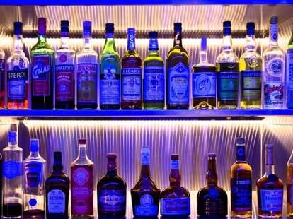 Two shelves full of liquor bottles