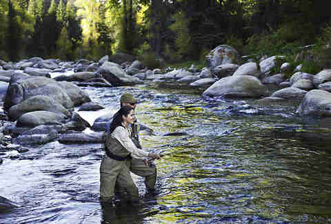 people fly fishing Roaring Fork River