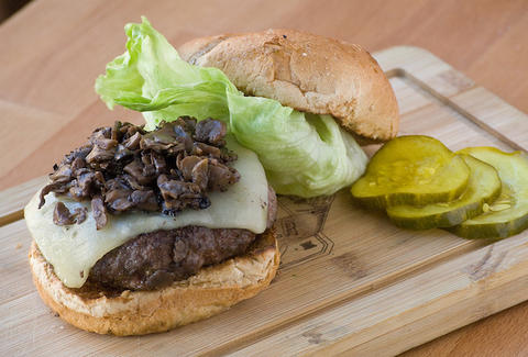Cheeseburger with mushrooms and lettuce