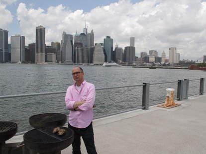 James Oseland grilling In Brooklyn Bridge Park