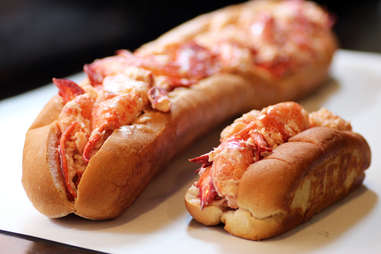 Pauli's North End USS Lobstitution lobster roll next to a standard lobster roll