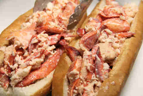 Piling more lobster on the USS Lobstitution lobster roll at Pauli's North End
