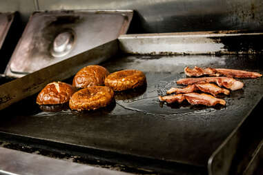Bacon and buns on the grill at Slater's 50/50 in San Diego.