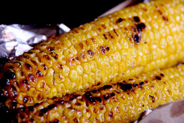 Cayenne honey buttered grilled corn from Serrano's Street Fare menu