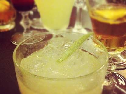 Closeup of a yellow cocktail with ice