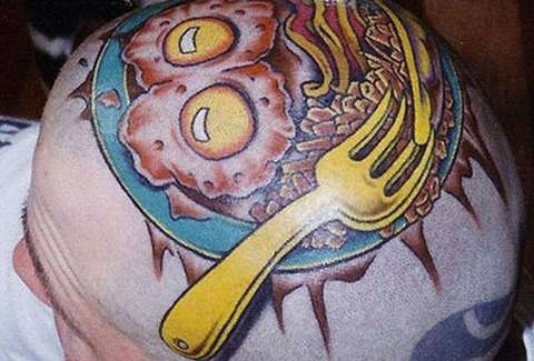 Eggs on head tattoo