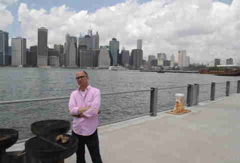 James Oseland grilling In Brooklyn Bridge Park