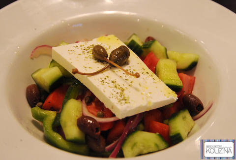 Greek salad with cucumbers, tomatoes, olives, onions, and feta cheese