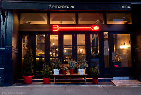 Exterior of Pitch and Fork with a glowing red pitch fork sign.