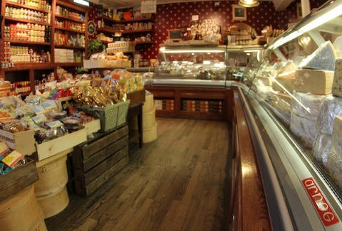 Interior of bedford cheese with a hundreds of cheeses and hard wood floors.