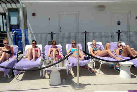 Girls sunbathing at the Fifth Floor pool at the Chelsea