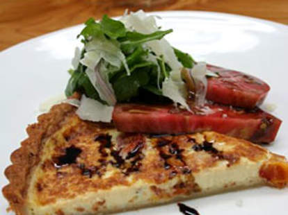 A quiche served with heirloom tomatoes