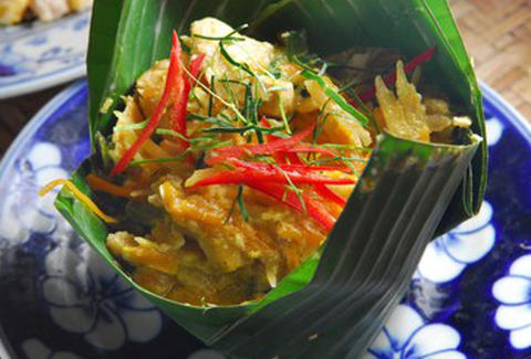 A traditional dish of Amok wrapped in banana leaves.