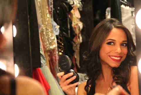 Royal Jelly dancer Alejandra smiles in the mirror backstage at Revel in Atlantic City