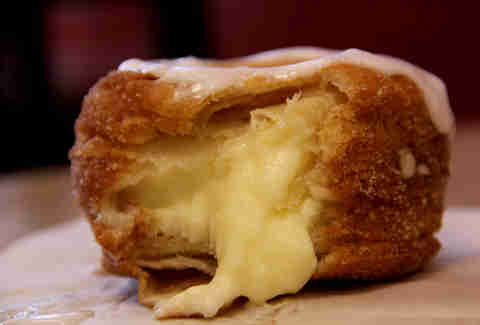 The inside of a Swiss Cro Creme Cronut at Swiss Haus Bakery