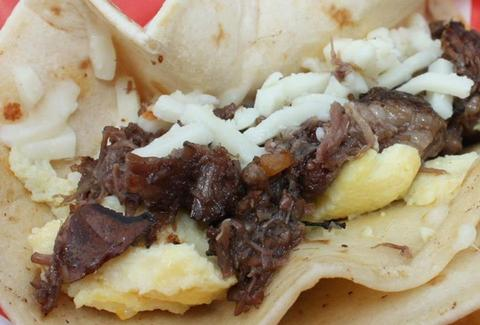 Barbacoa/egg breakfast taco at WhaTaTaco
