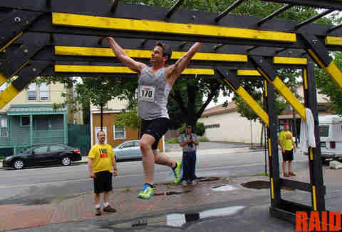 Dude on the monkey bars at Urban RAID