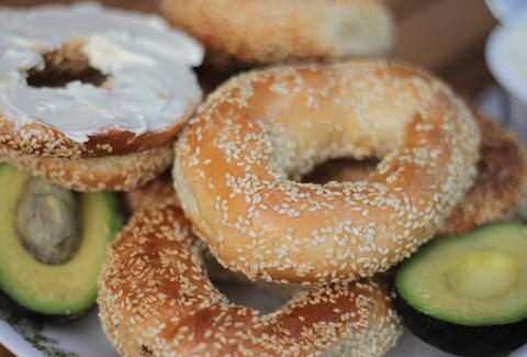 Montreal sesame bagels with cream cheese and avocado
