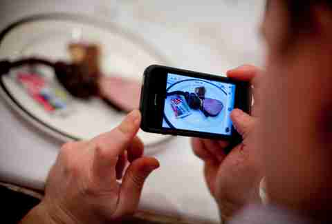A fan takes a photo of food at a Cochon Epic event