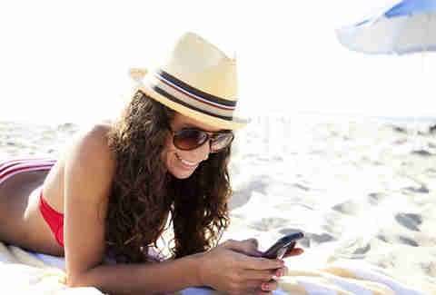 Woman on beach texting