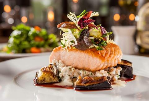 Salmon with risotto and eggplant at Bianca in Miami, FL