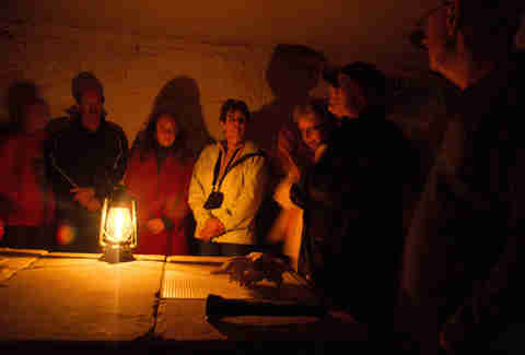 Paranormal Investigation Experience group in Senior Surgeon's basement