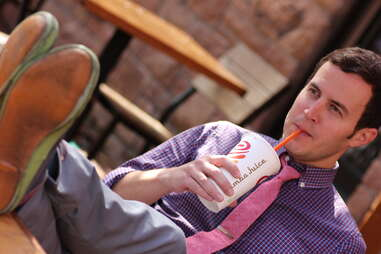 a guy drinking a boozy smoothie