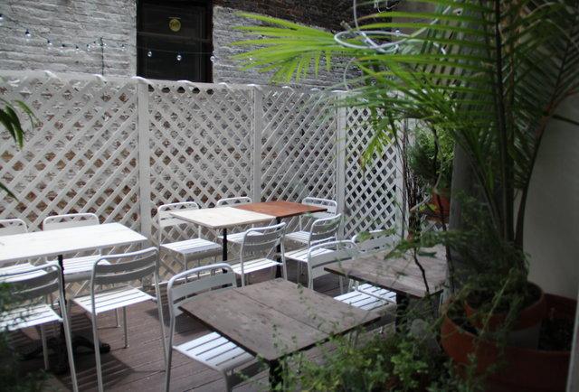A beer garden hidden behind an Italian spot