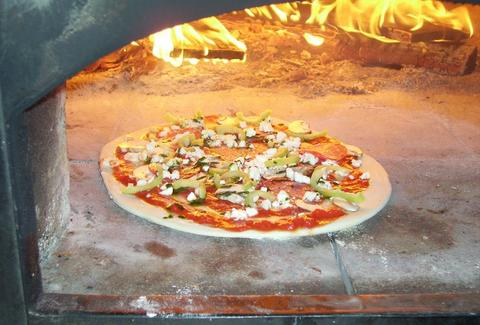 pizza in the oven at Extra Virgin Oven, EVO -- Charleston, SC