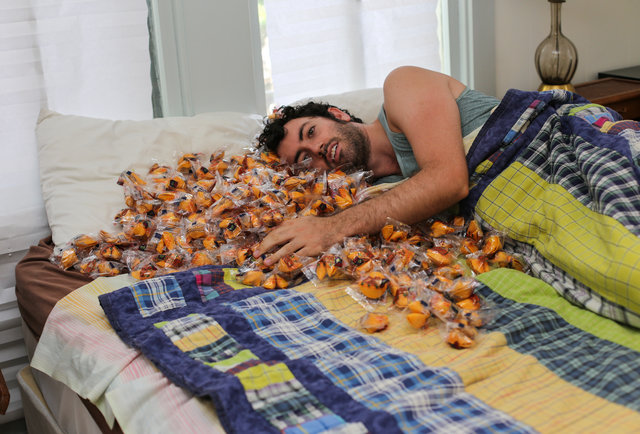 We opened 350 fortune cookies... in bed!