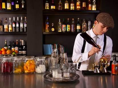 Bartender behind the bar at Bellocq