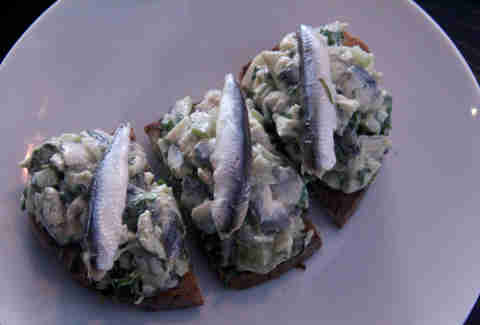 Spanish white sardine toasts at a.bar
