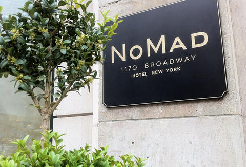 NoMad sign and greenery