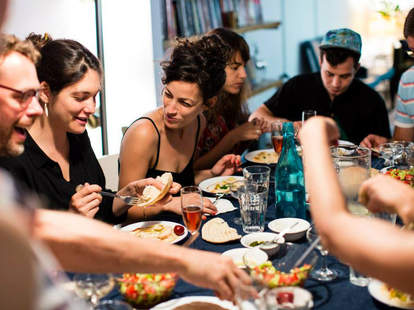People sitting around a table at a dinner party