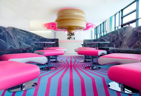 Vibrantly colored bar inside nhow Berlin