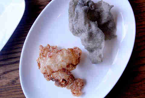 Momofuku Ssam Bar's beef tendon and black garlic chips.