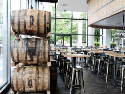 Casks and tables inside White Oak Kitchen & Cocktails