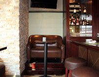 Brown leather chair near the bar