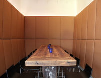 Long wooden table inside Sip