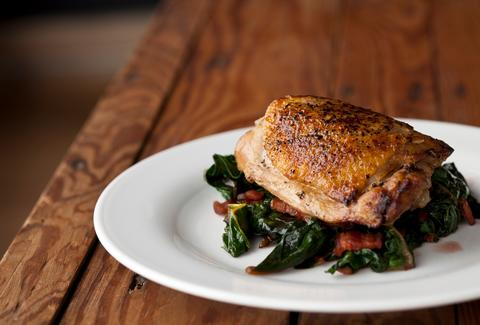 Swan Creeks Farm's half roasted chicken served over greens.