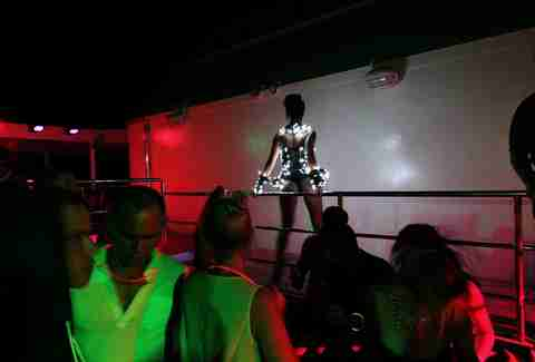 Dancer in lights on Resorts World Bimini Superfast Night Cruise