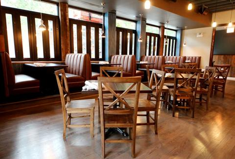 Crosby's interior with dark wood tables and booths.