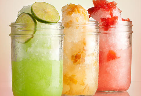 Various flavors of shaved ice served in jars.