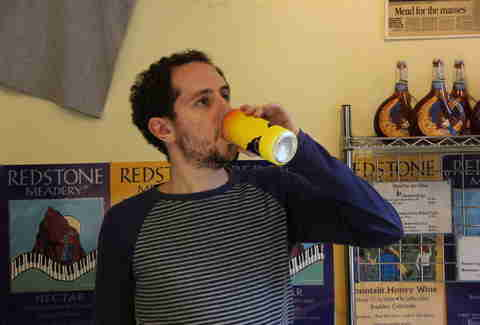 guy drinking Redstone Meadery can of mead