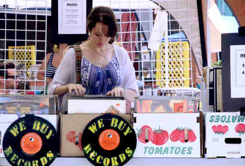 A girl browsing records at the Brooklyn Flea Philly