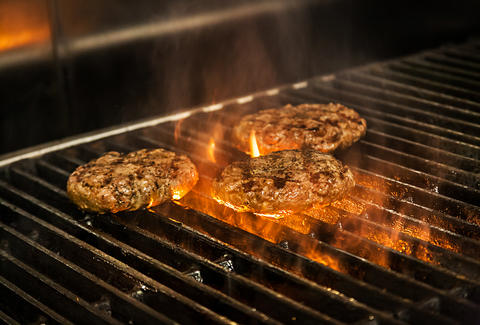 Cooking the beef patty for the Supreme Nacho Burger at Slater's 50/50 in Liberty Station San Diego.